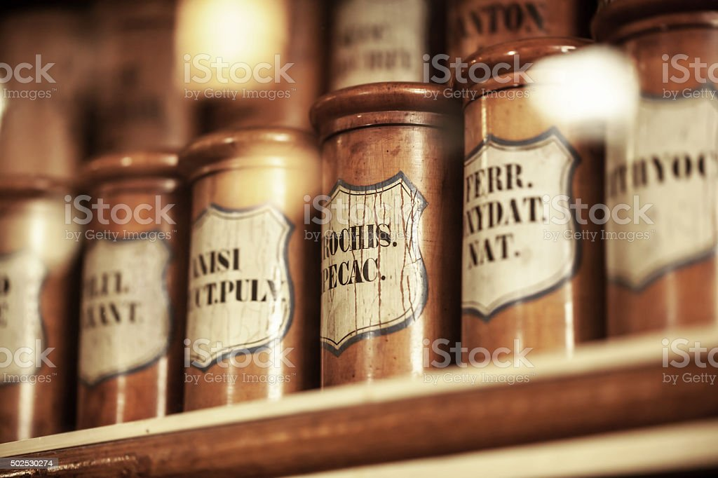 vintage medications in small bottles stock photo
