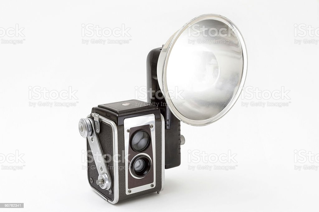 Vintage Medium Format Camera with Flash on White Backdrop stock photo