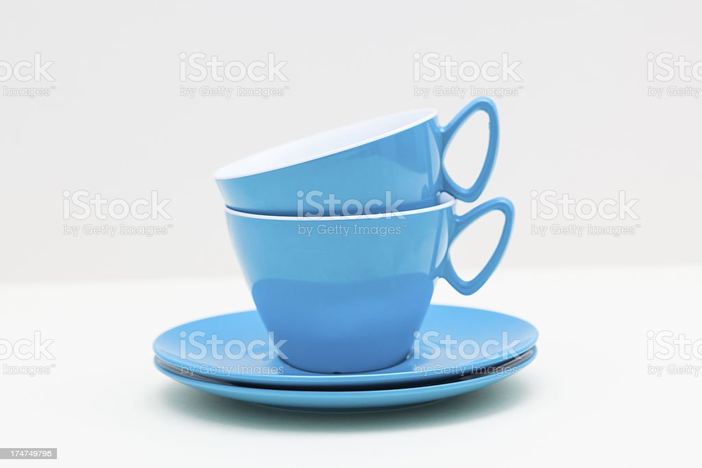 Vintage Melamine Turquoise Cups and Saucers stock photo