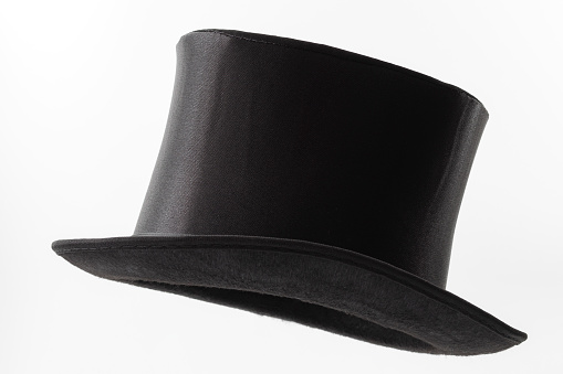 Vintage men fashion and magic show conceptual idea with side profile angle on victorian black top hat with clipping path cutout in ghost mannequin technique isolated on white background
