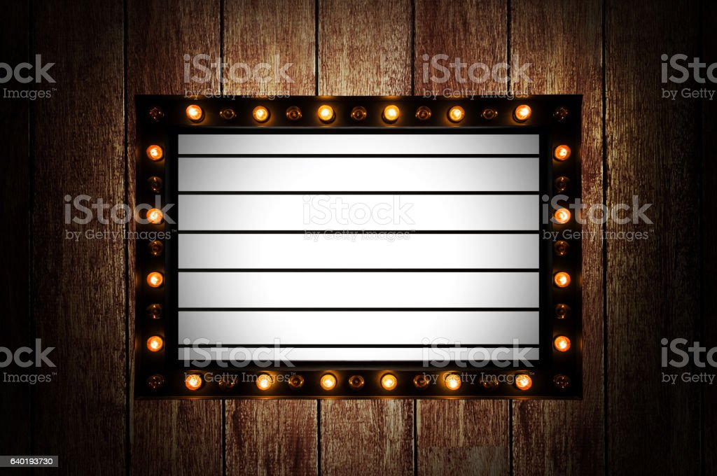 Vintage message board with light box and light bulb stock photo
