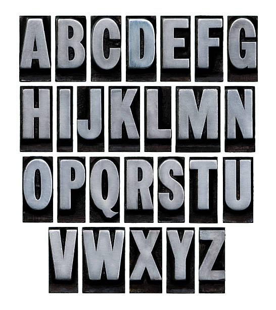 a vintage metal alphabet set on a white background - weihnachten 個照片及圖片檔