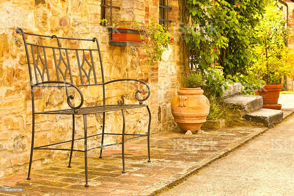 Vintage Metal Bench in Front of Farmhouse, Tuscany, Italy royalty-free stock photo