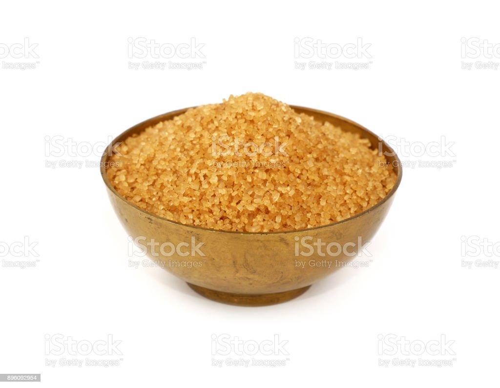 Vintage metal bowl full of brown cane sugar stock photo