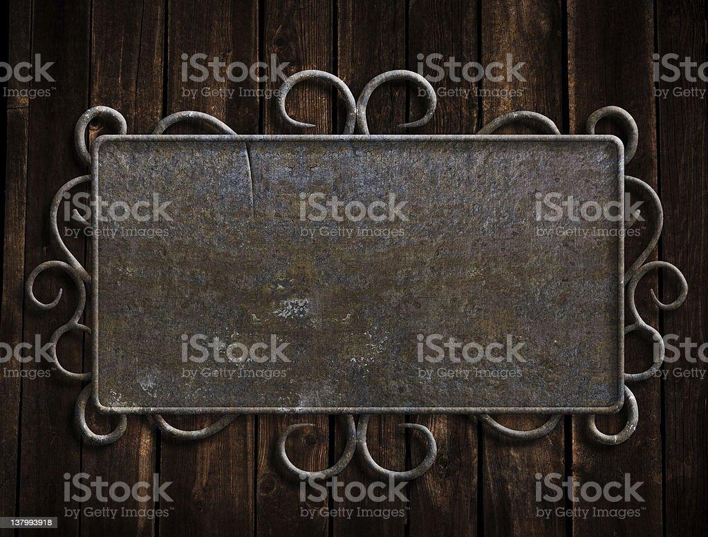 Vintage metal plate  on old wooden door royalty-free stock photo