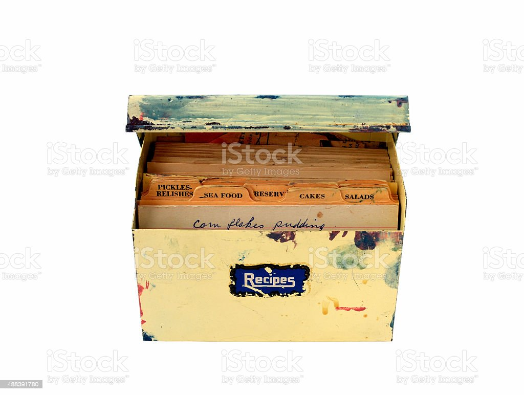 vintage metal recipe box with recipes inside stock photo