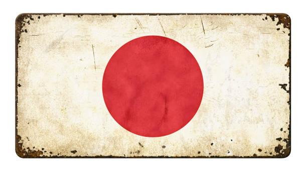 letrero de metal vintage sobre un fondo blanco - bandera de japón - insignia símbolo fotografías e imágenes de stock