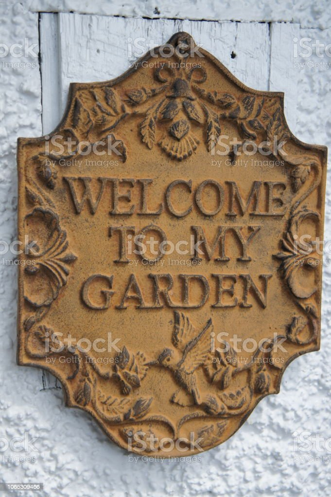 Vintage metal welcome to my garden sign stock photo
