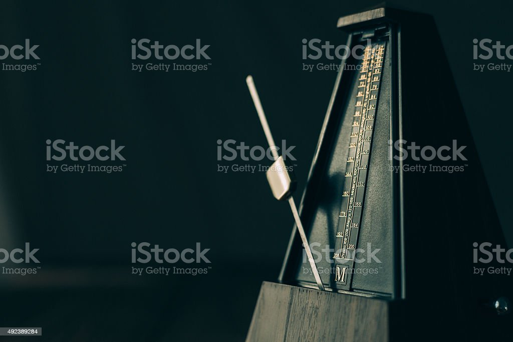 Vintage metronome, on a dark background. stock photo