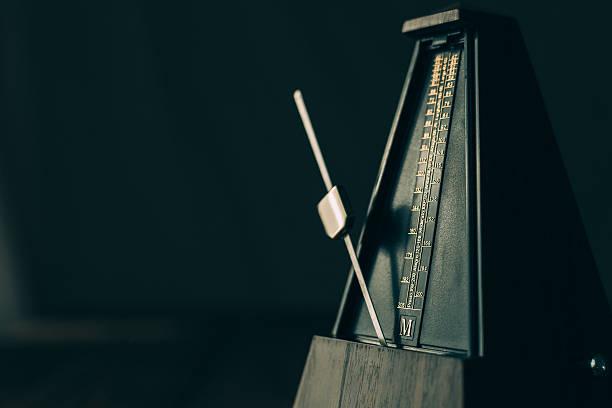 Vintage metronome, on a dark background. stock photo