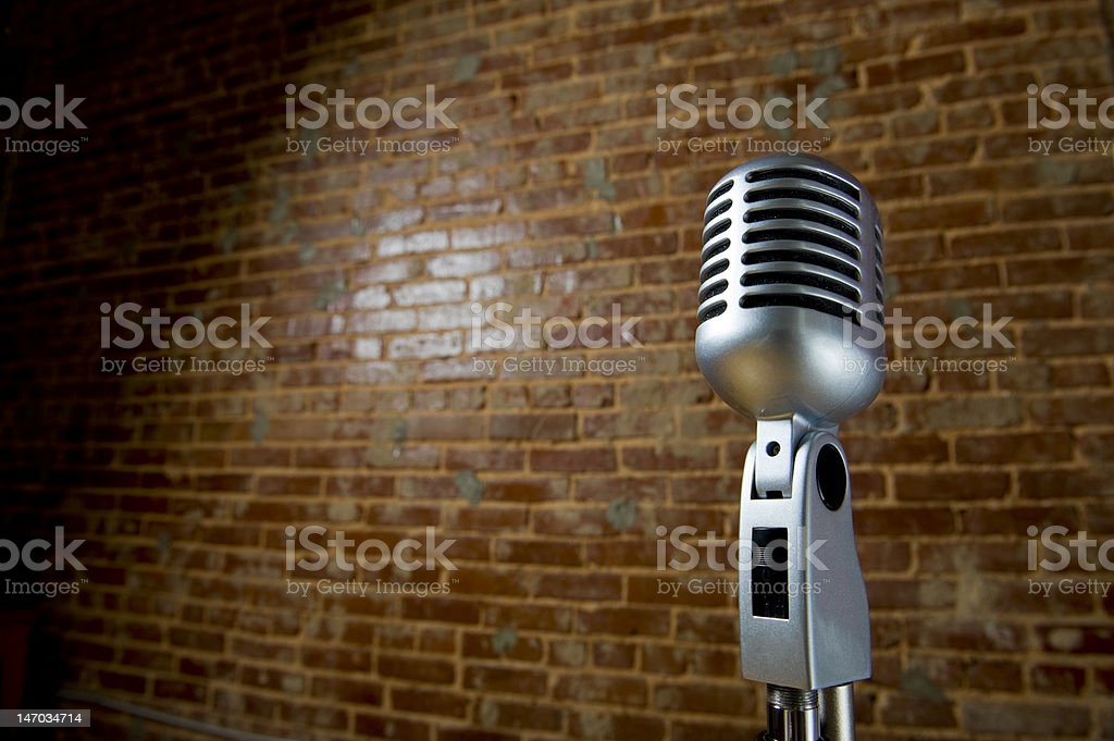 Vintage Microhone and brick wall stock photo