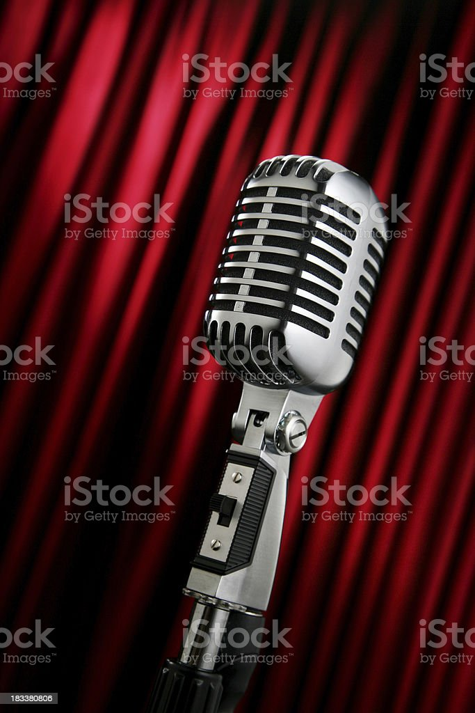 Vintage Microphone Against a Red Curtain royalty-free stock photo