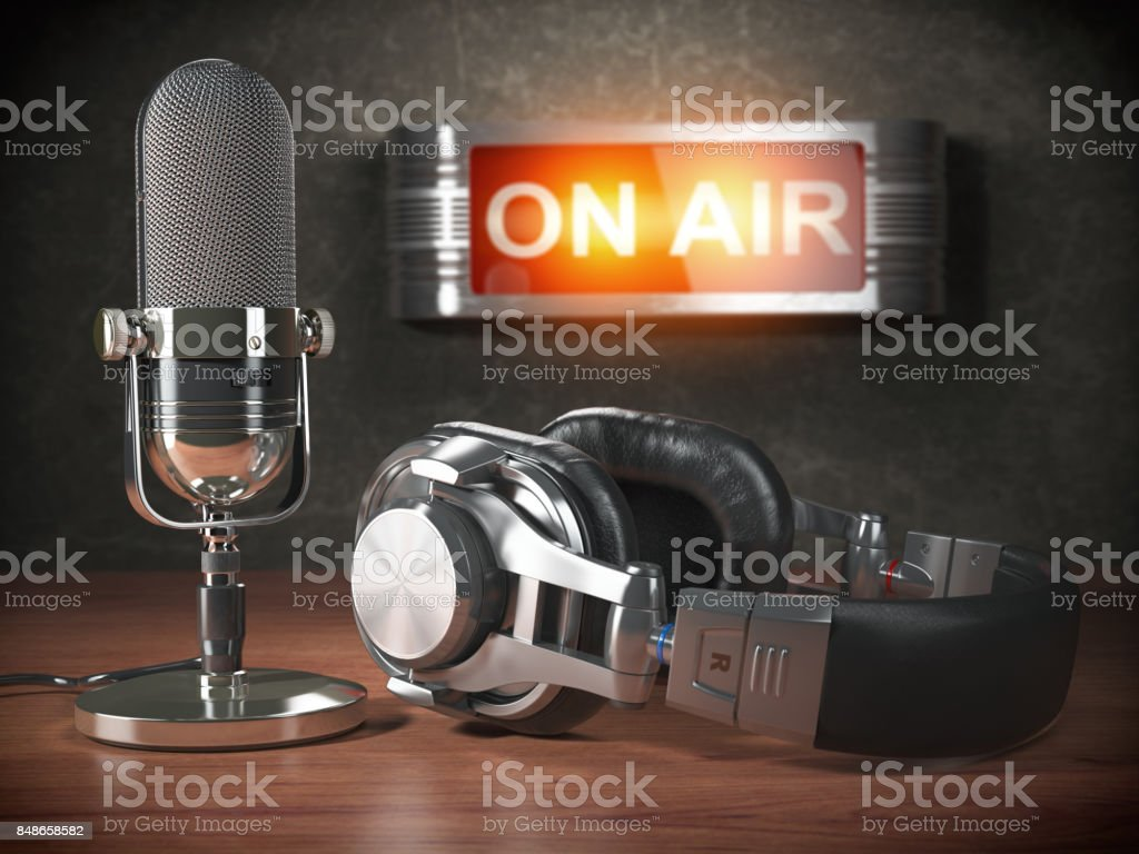Vintage microphone  and headphones with signboard on air. Broadcasting radio station concept. stock photo