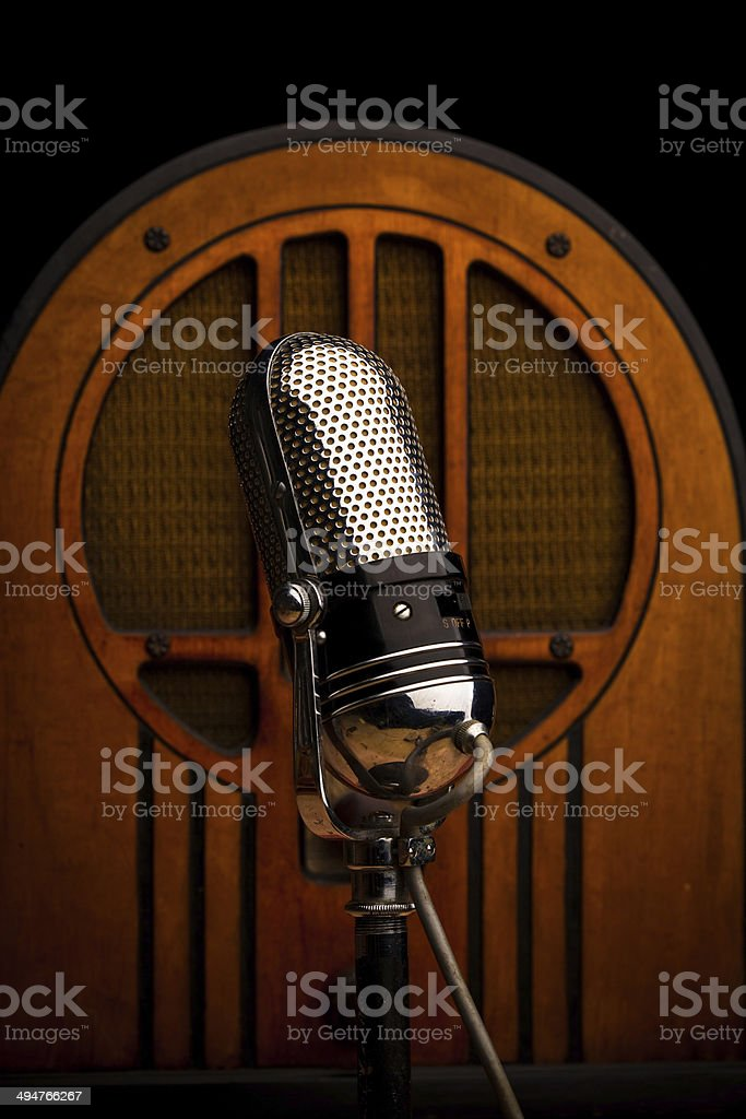 Vintage Microphone and Wood Radio Still Life stock photo