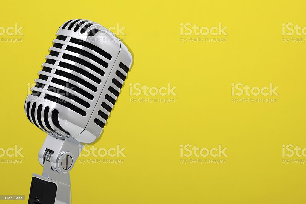 Vintage microphone isolated on yellow royalty-free stock photo