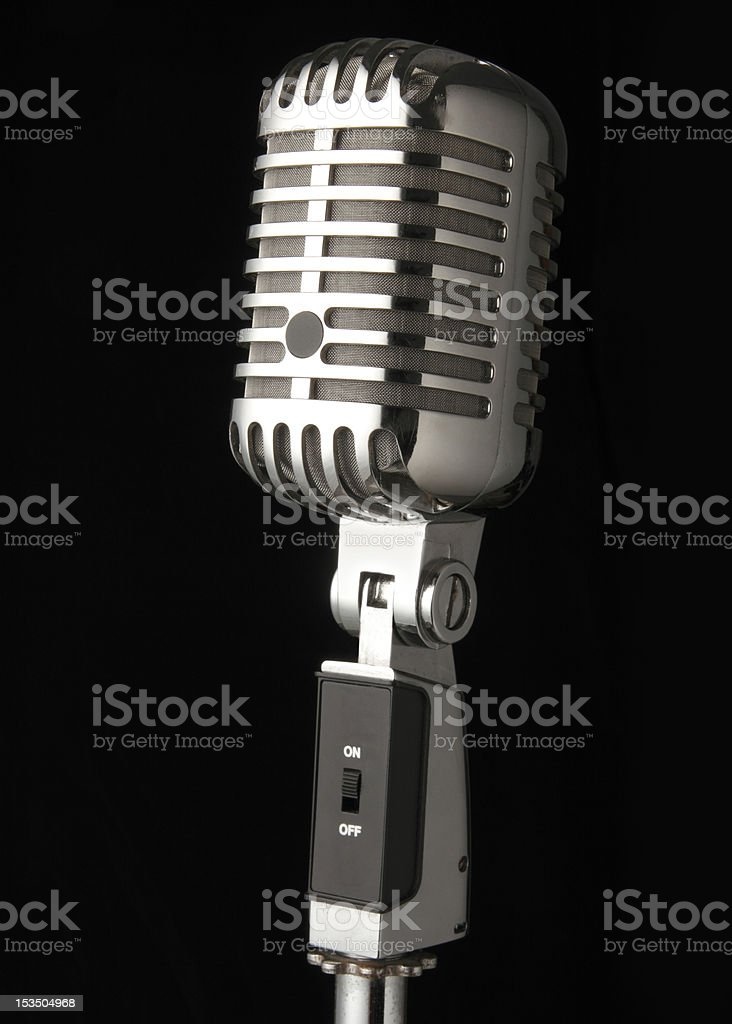 Vintage Microphone on a Black Background stock photo