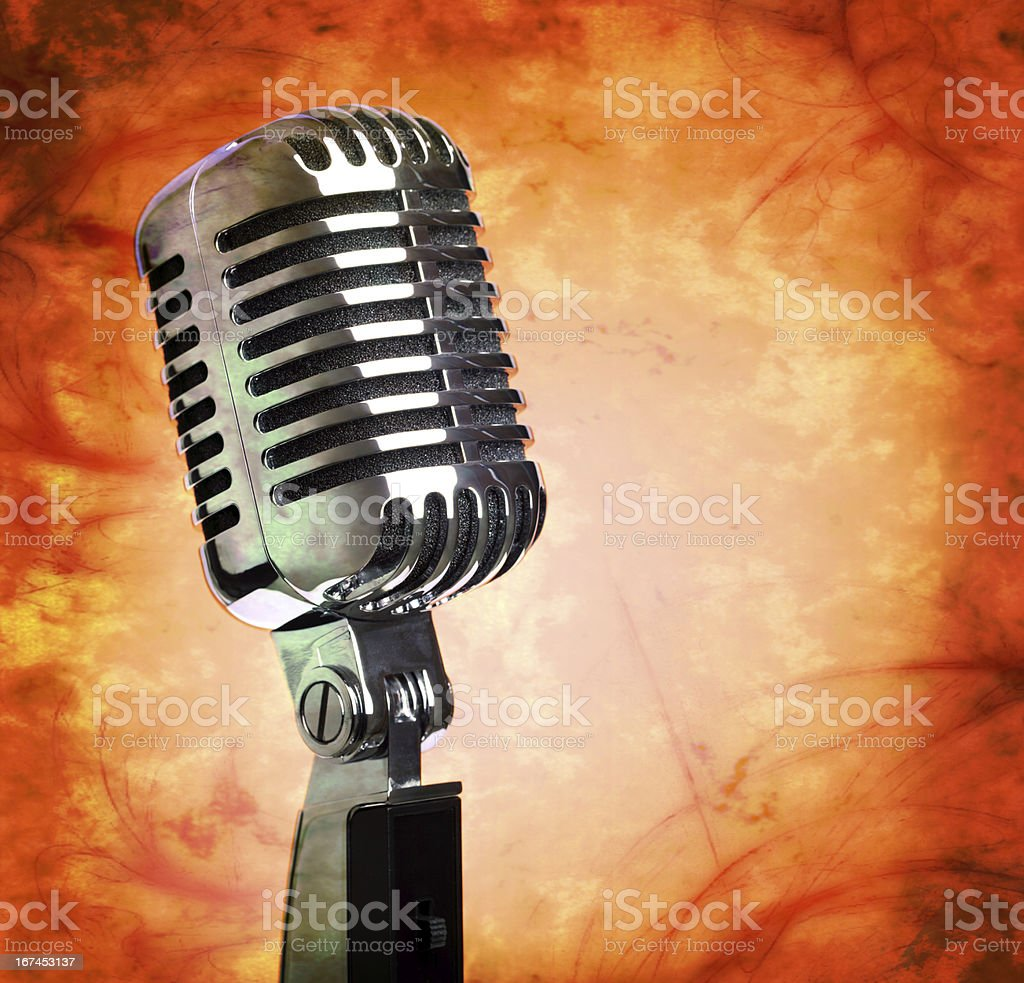 Vintage microphone on grunge background royalty-free stock photo