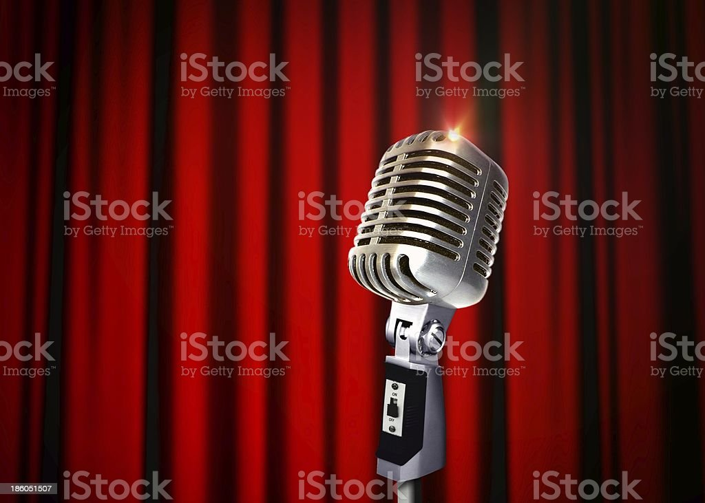 Vintage Microphone over Red Curtains stock photo