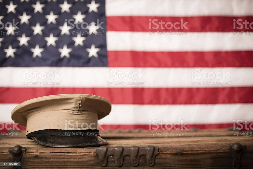 Vintage Military Hat in Front of American Flag royalty-free stock photo