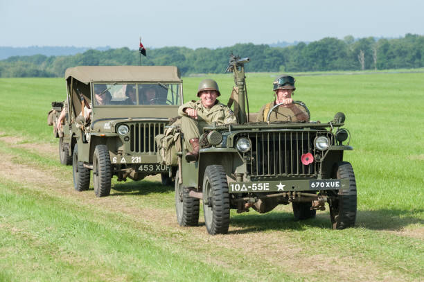 vintage military jeeps Dunsfold, UK - August 26, 2017: Part of a parade of vintage military jeeps at a gathering of classic and modern vehicles in Dunsfold, UK willys stock pictures, royalty-free photos & images
