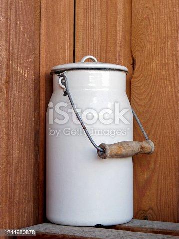 Vintage milk can, metal body with white enamel coating.