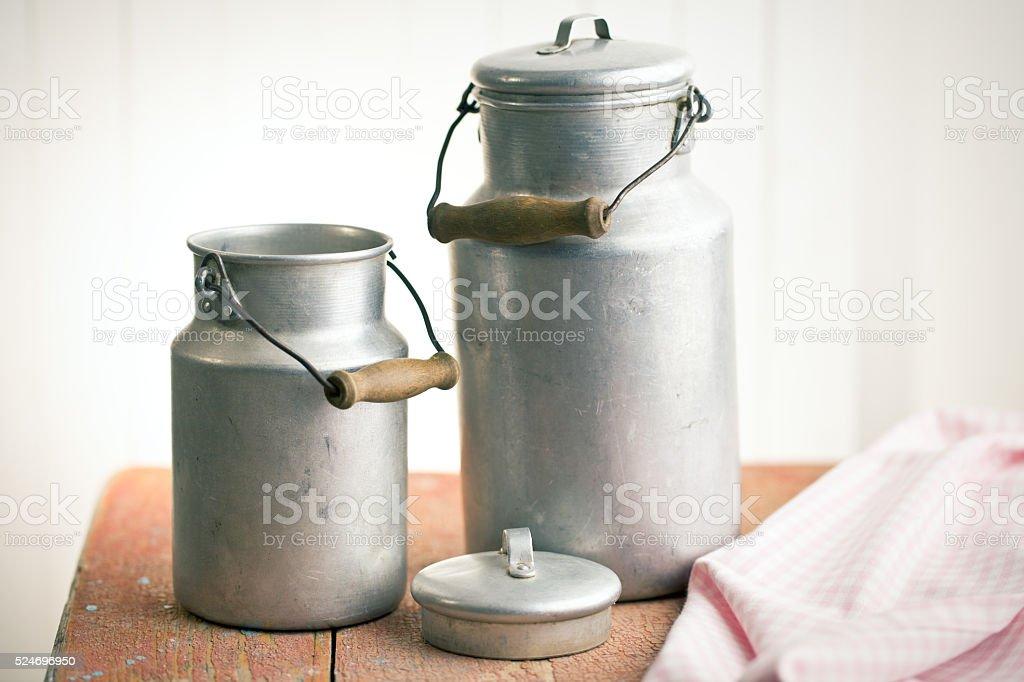 vintage milk cans stock photo