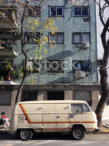 Buenos Aires, Argentina - May 24, 2019: Old mini van in good condition parked in the street next to sidewalk. Lots of cars like this can still be found moving around the city