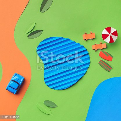 912120622 istock photo Vintage miniature car in trendy color, travel concept 912116572