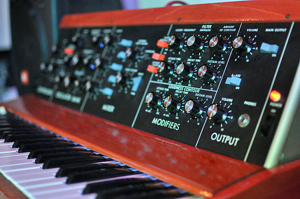 Vintage Minimoog Synthesizer Vintage classic Minimoog analog synthesizer.  In production between 1970 and 1981, and costing between $4500-$9500.  A staple of progressive rock music, but also used by the Beatles and many other bands.  This photo taken 6/11/2011. synthesizer stock pictures, royalty-free photos & images
