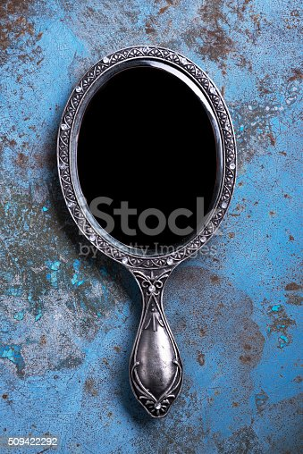 Beautiful vintage isolated hand mirror.