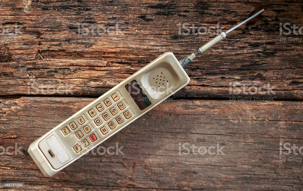 vintage mobile phone on wooden stock photo