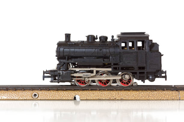 vintage model steam locomotive on the rails - modellbahnanlagen stock-fotos und bilder