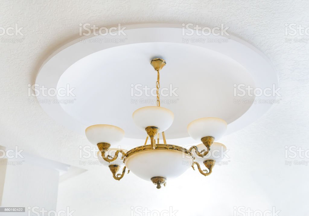 Vintage modern chandelier on white wall stock photo
