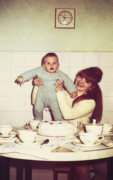 Vintage mommy and baby in the kitchen stock photo