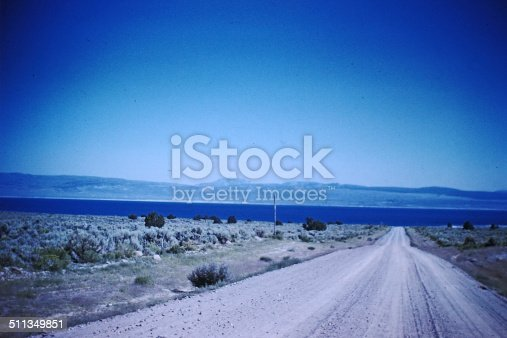 1960s scanned slide of gravel road approach to California's Mono Lake Horizontal.