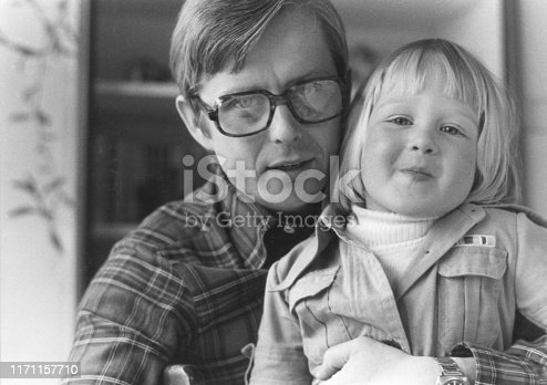 Vintage monochrome 1970´s portrait of happy father and daughter.