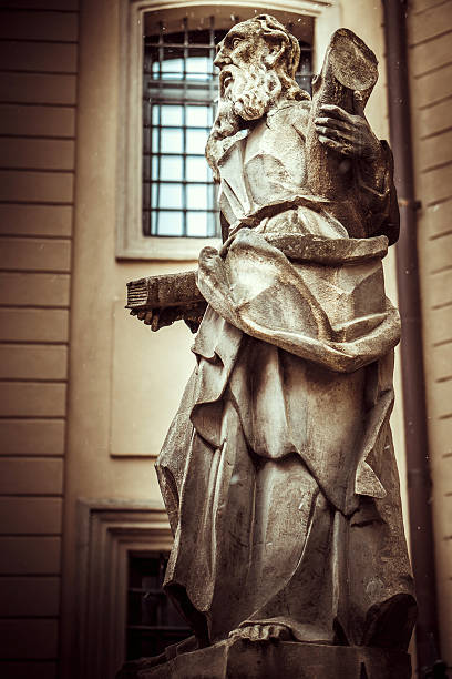 Vintage monument of old male figure stock photo