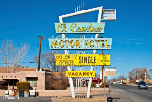 Albuquerque, USA - January 28, 2014: El Camino Motel Sign. Route 66 is one of the most recognizable and most popular historic routes in the nation. Its name commonly evokes images of the busy highway still standing, motels, gas stations, and cafes.