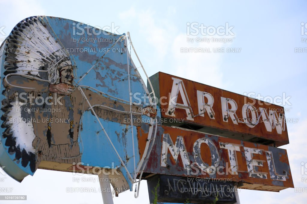 Vintage Motel Sign with Native American Image, NM stock photo