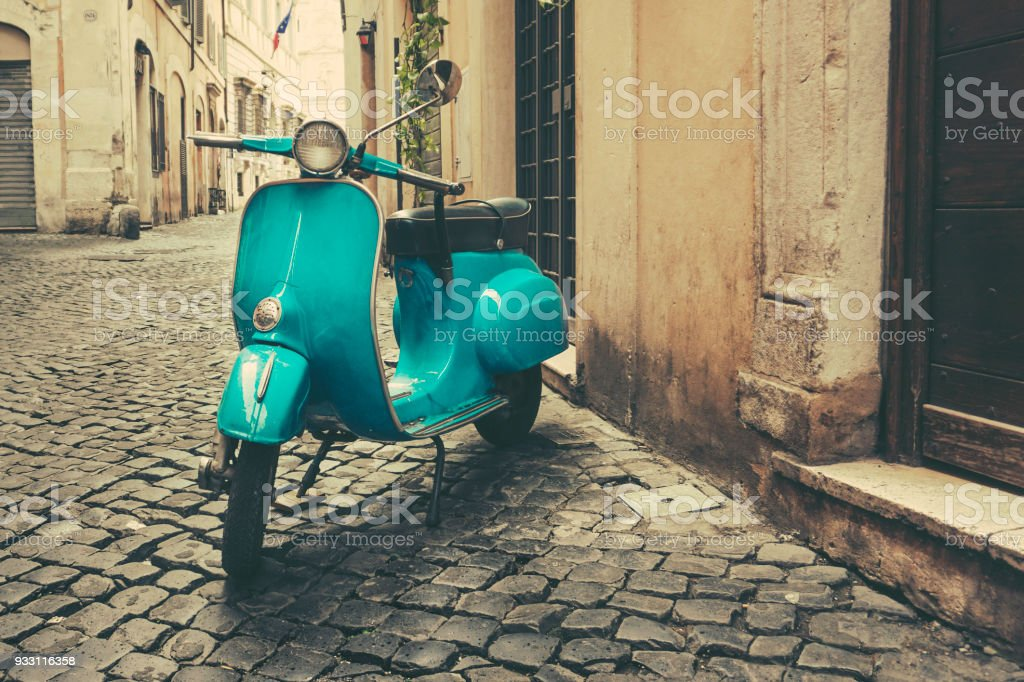 Vintage motor scooter on the street in Italy stock photo