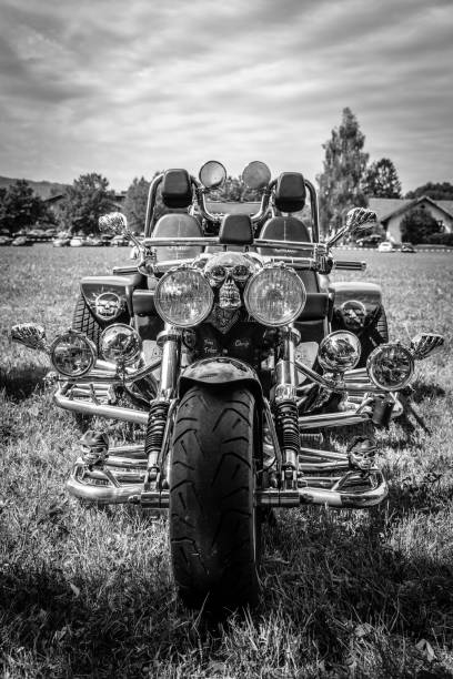 Vintage motorbike on green park Mondsee, Austria - August 5, 2017: Vintage motorbike on green park in a Motorcycles Fair three wheel motorcycle stock pictures, royalty-free photos & images