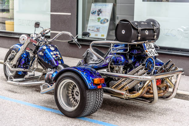 Vintage motorbike three wheeler in the street Mondsee, Austria - August 5, 2017: Vintage motorbike three wheeler in the street in a Motorcycles Fair three wheel motorcycle stock pictures, royalty-free photos & images