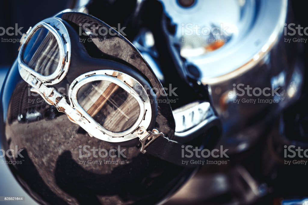 Vintage motorcycle helmet placed on a motorbike - Motorcycle Transport Safety Detail Backgrounds stock photo