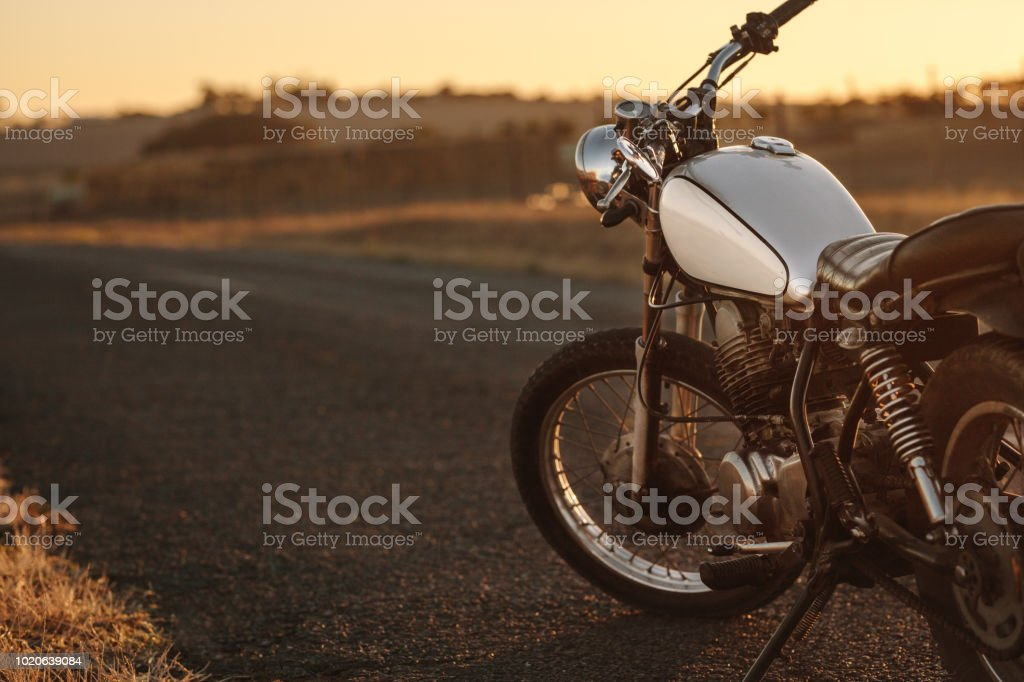 Vintage motorcycle on country road stock photo