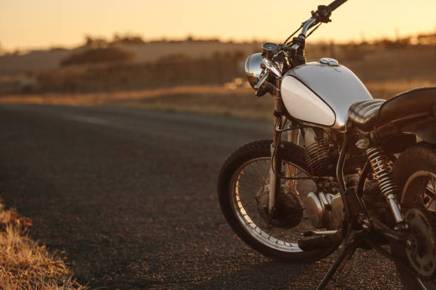vintage motorcycle on country road - motorcycle stock photos and pictures