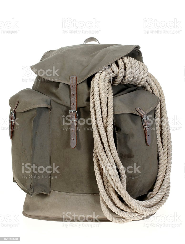 Vintage mountaineering backpack with climbing rope stock photo