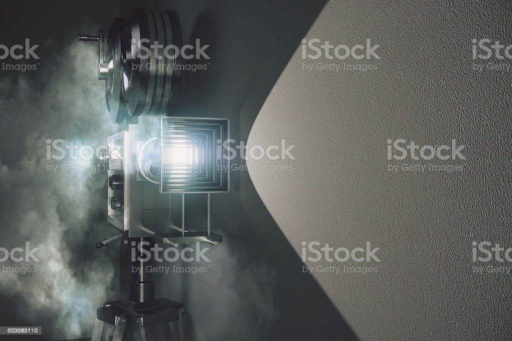 Vintage movie camera in the fog and grey wall stock photo