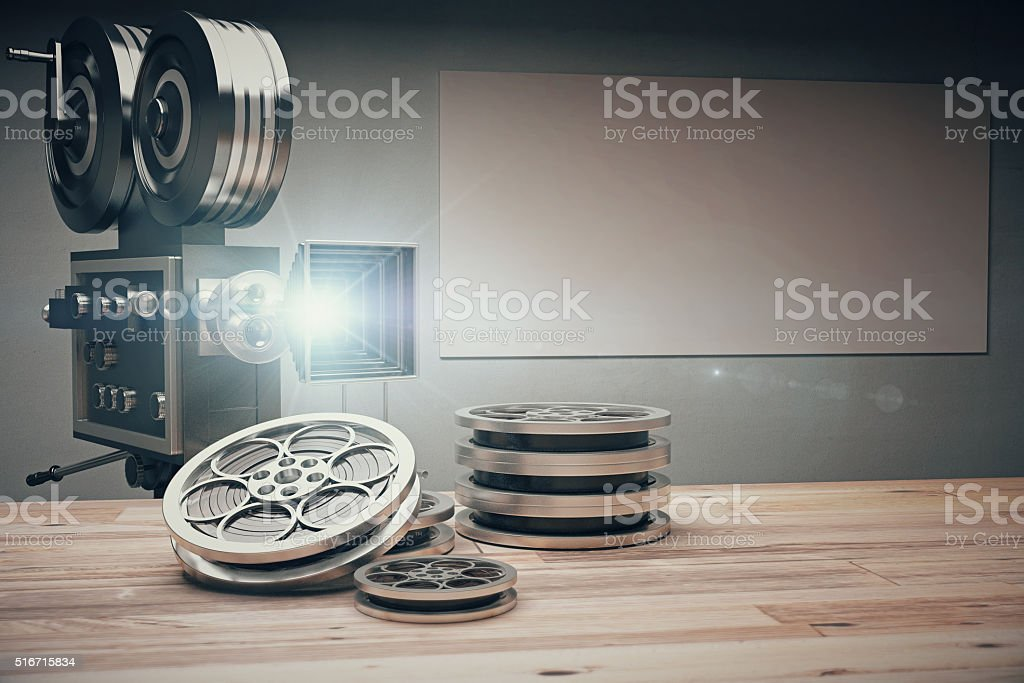 Vintage movie camera with Old style cassettes and film stock photo