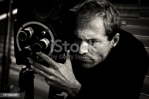 vintage movie director/cameraman filming a dramatic moment