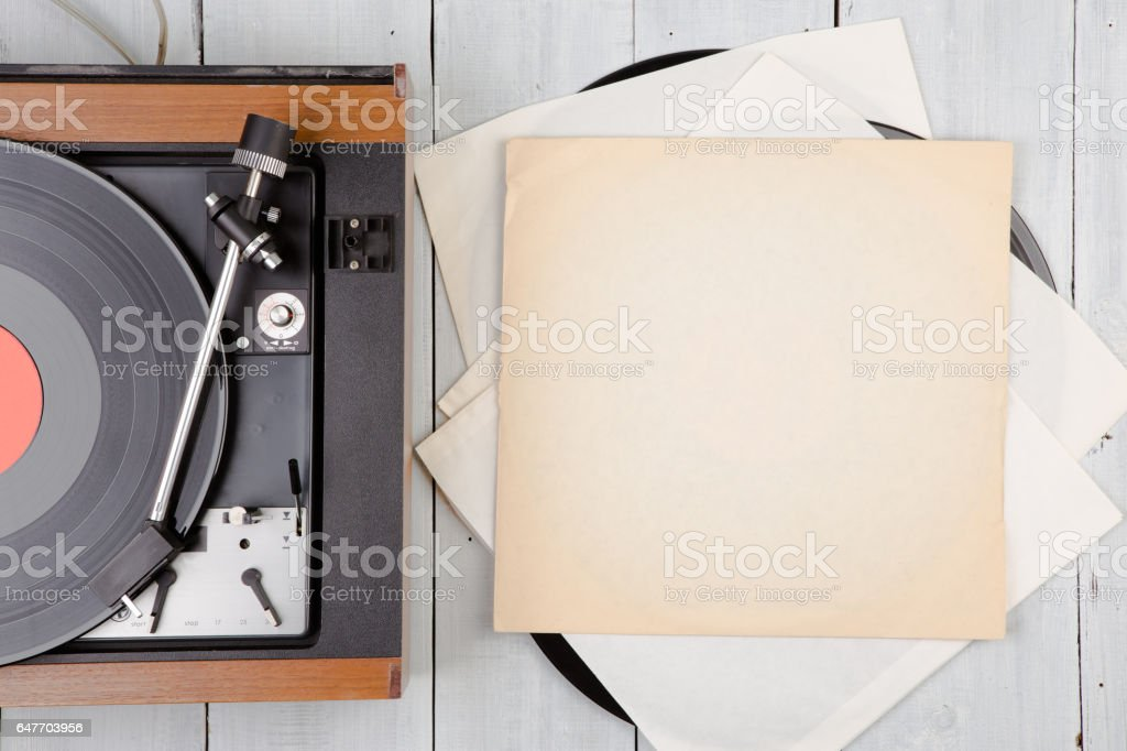 vintage music player turntable with lp stock photo